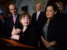 Charlie Lowthian-Rickert, who is transgender, speaks along side Justice Minister Jody Wilson-Raybould, right, as she makes an announcement in the foyer of the house of commons on Parliament Hill in Ottawa on Tuesday, May 17, 2016, regarding legislation on gender identity and gender expression.
