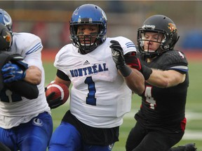 Montreal Carabins' Sean Thomas-Erlington, centre, was named Team East's offensive player of the Canadian Interuniversity Sport East-West Bowl on Saturday, May 14, 2016, after rushing for 93 yards on nine carries.