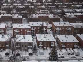 A winter view of homes and residential apartment buildings after snow fall in the borough of Cote-des-Neiges seen from the K Pavilion of the Jewish General Hospital in Montreal on Monday, January 18, 2016.
