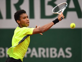 Montreal's Félix Auger-Aliassime hits a backhand during the boys' singles final match against Geoffrey Blancaneaux of France on Day 15 of the French Open at Roland Garros on June 5, 2016 in Paris, France.