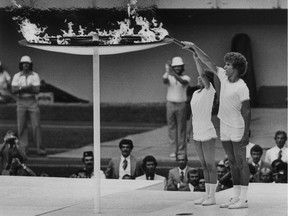 Sandra Henderson and Stéphane Préfontaine light the Olympic flame during the opening ceremony for the 1976 Summer Olympic Games in Montreal.