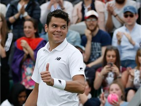 Canada's Milos Raonic celebrates beating Italy's Andreas Seppi during their men's singles second round match on the fourth day of the 2016 Wimbledon Championships at The All England Lawn Tennis Club in Wimbledon, southwest London, on June 30, 2016.