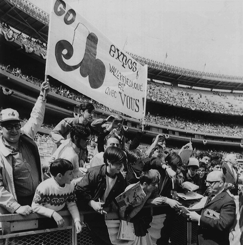 Autographs - Montreal Mayor Jean Drapeau signs autographs for Montreal Expo fans before the National League Expansion team took on the New York Mets in season opener in New York's Shea Stadium. AP wirephoto. 1969. Montreal Mayor Jean Drapeau (right) signs autographs for Expos fans before club took on the Mets April 8, 1969, in their season and franchise opener at New York's Shea Stadium.
