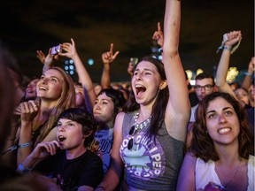 Music fans cheer during the set by Red Hot Chili Peppers on Day One of the Osheaga Music and Arts Festival at Parc Jean-Drapeau on Friday, July 29, 2016.