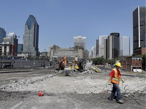 Crews work on the demolition of the Bonaventure Expressway in Montreal on Wednesday July 6, 2016.