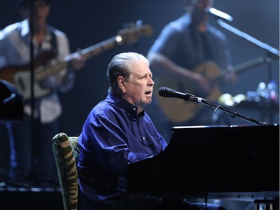 Brian Wilson of Beach Boys fame performs at the piano, middle, at Salle Wilfrid-Pelletier of Place des Arts as part of the Montreal International Jazz Festival on Thursday, July 7, 2016, along with Al Jardine and Blondie Chaplin.