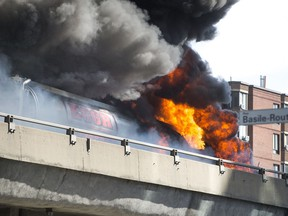 A tractor trailer carrying fuel burns on the elevated highway by Crémazie and Basile Routhier in Montreal Aug. 9, 2016.