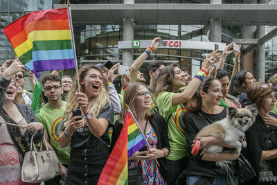 A crowd cheers as they get a glimpse of Canadian Prime Minister Justin Trudeau during the Montreal Pride Parade through Rene-Levesque boulevard in downtown Montreal on Sunday, August 14, 2016.