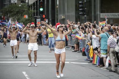 People take part in the Montreal Pride Parade as it goes through Rene-Levesque boulevard in downtown Montreal on Sunday, August 14, 2016.