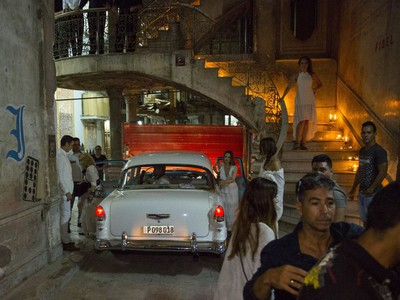 Madonna, left, gets out of a classic American car at a restaurant where she was celebrating her 58th birthday in Havana, Cuba, Tuesday, Aug. 16, 2016.