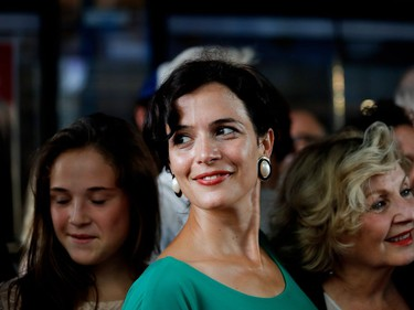 Catherine de Léan, who plays Mignonne, poses on the red carpet outside the Imperial Cinema Thursday, Aug. 25, 2016 for the première of Quebec director André Forcier's Embrasse-moi comme tu m'aimes, the opening film of the Festival des films du monde.