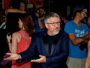 Comedian and actor Benoît Brière jokes with photographers on the red carpet outside the Imperial Cinema Thursday, Aug. 25, 2016 for the première of Quebec director André Forcier's Embrasse-moi comme tu m'aimes, the opening film of the Festival des films du monde.