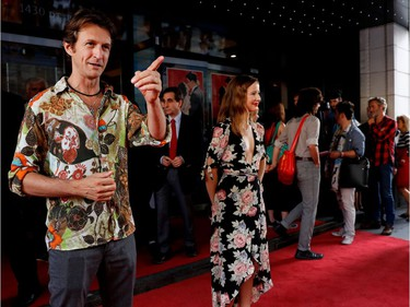 Stéphane Crête, who plays M. Rivest, and Juliette Gosselin, who plays Berthe Sauvageau, pose on the red carpet outside the Imperial Cinema Thursday, Aug. 25, 2016 for the première of Quebec director André Forcier's Embrasse-moi comme tu m'aimes, the opening film of the Festival des films du monde.