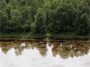 Oil can be seen on the North Saskatchewan river near Maidstone, Sask on Friday July 22, 2016. Husky Energy has said between 200,000 and 250,000 litres of crude oil and other material leaked into the river on Thursday from its pipeline.