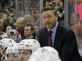 In this Feb. 7, 2015, file photo, Colorado Avalanche head coach Patrick Roy watches from the bench during the third period of an NHL hockey game against the Minnesota Wild in St. Paul, Minn.
