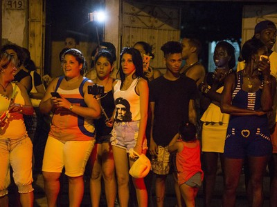 People wait to get a glimpse of as she arrives at a restaurant where she was celebrating her 58th birthday in Havana, Cuba, Tuesday, Aug. 16, 2016.