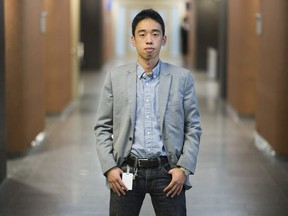 Journal de Montréal court reporter Michael Nguyen poses for a photograph at the Montreal Courthouse, Thursday, September 22, 2016.