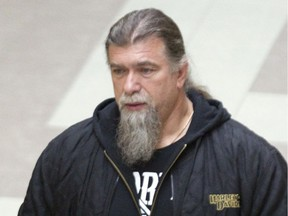 In 2014, Salvatore Cazzetta, the alleged leader of the Hells Angels in Quebec, leaves a Longueuil courthouse.