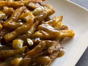 Local Input~ Canadian cuisine, Poutine, gravy, french fries, and cheese curd. Credit: Getty Images.  1006 ar poutine origins