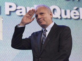 Parti Quebécois leadership candidate Jean-François Lisée waves to supporters after speaking to them before hearing the leadership results, at the Parti Québécois leadership race results evening, Friday, Oct. 7, 2016 in Lévis.