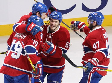 Montreal Canadiens defenceman Shea Weber (6) celebrates his first Habs goal with teammates Andrei Markov (79), Andrew Shaw (65) and Alexander Radulov (47) during second period NHL action in Montreal on Thursday October 20, 2016.