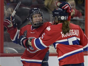 Les Canadiennes de Montreal Marie-Philip Poulin (29) celebrates with teammate Lauriane Rougeau (5), right, during the Clarkson Cup final in March. The Canadiennes will face the Calgary Inferno again Saturday at the Bell Centre.