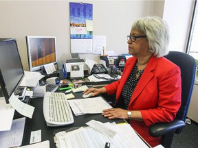 Jennifer Jones at work at KBHNS accountants in Montreal Thursday May 7, 2015. Thanks to the drug Perjeta, Jones is in remission after battling stage 4 breast cancer for two years. When she turns 65 on Friday her private insurance ends and Quebec doesn't cover the cost of this drug yet.