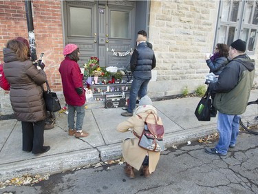 Leonard Cohen fans pay tribute outside the late singer/songwriter's house on Vallières in Montreal, Friday November 11, 2016.  Cohen died in 82 overnight on Thursday the 10th.