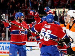 Canadiens defenceman Greg Pateryn celebrates scoring against Philadelphia Flyers goalie Michal Neuvirth as Flyers defenceman Michael Del Zotto, right, heads to the bench during NHL action at the Bell Centre in Montreal on Saturday, Nov. 5, 2016.