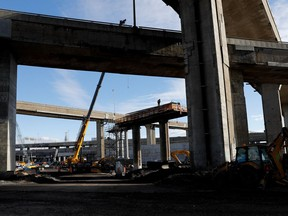A worker secures rebar to a new pillar of the Turcot Exchange project Nov. 9, 2016.