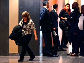 Rosa Robinson, left, mother of victim Pamela Jean, leaves the courtroom during a break in Juan Fermin Palma's murder trial at Montreal's Palais de Justice Nov. 8, 2016.