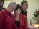 Manon Boyer, centre, aunt of Éloïse Dupuis, and Marie-Chantal Dubé, left, a friend of Éloïse, and Boyer's friend Robert Beauchemin, right, become emotional as they listen to a song during a memorial event for Dupuis in Laval on Saturday, Dec. 3, 2016.