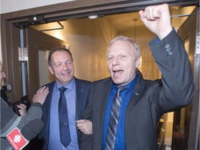 Parti Quebecois candidate Marc Bourcier, left, arrives with PQ leader Jean-Francois Lisee, after winning the provincial byelection to replace Pierre Karl Peladeau, Monday, December 5, 2016 in Saint-Jerome, Que.