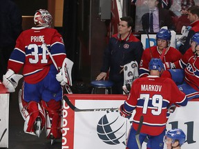 Canadiens goalie Carey Price looks toward the team's bench after being pulled from the game after a goal by San Jose Sharks' Melker Karlsson during second period NHL action in Montreal on Friday, Dec. 16, 2016.