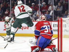 Minnesota Wild's Eric Staal jumps in front of Montreal Canadiens Carey Price as Wild teammate Matt Dumba takes a shot during second period of National Hockey League game in Montreal Thursday Dec. 22, 2016.