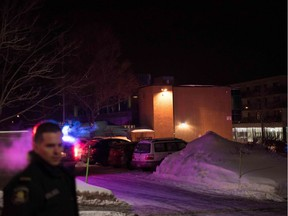 Police officers respond to a shooting in a mosque at a Quebec City mosque on Ste-Foy St. on Sunday, Jan. 29, 2017.