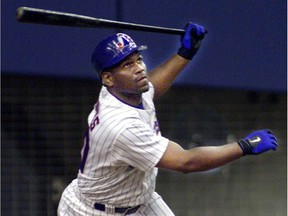 Montreal Expos outfielder Tim Raines bats against the New York Mets during the home opener at Olympic Stadium on April 4, 2001.