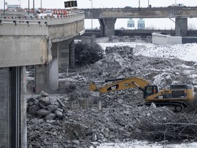 A mechanical shovel is used to demolish a section of the Turcot Interchange in December 2016.