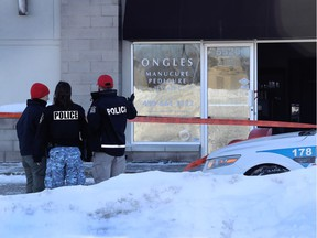 Laval police officers stand in front of Streakz Coiffure, owned by Polisena Delle Donne, the wife of Guiseppe Torre, 45. The hair salon was firebombed this morning in Laval on January 5, 2107.  (Marie-France Coallier / MONTREAL GAZETTE)