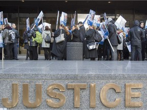Quebec Lawyers and notaries march at the Montreal courthouse Oct. 24, 2016, as part of the first day of a general strike.