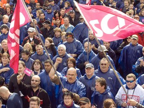 Thousands of Montreal blue-collar workers, joined by blue-collar workers from other regions of Canada rallied outside Montreal city hall Wednesday, October 7, 2009 to protest lagging contract talks with the City.