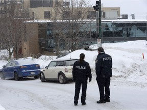 Police attend the scene of a shooting at a Quebec City mosque on Monday January 30, 2017. A shooting at a Quebec City mosque left six people dead and eight others injured Sunday.