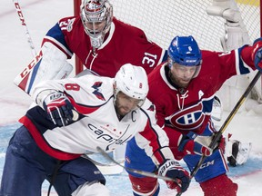 Montreal Canadiens defenceman Shea Weber (6) takes Washington Capitals left wing Alex Ovechkin (8) out from in front of goalie Carey Price (31) during first period NHL hockey action Monday, January 9, 2017 in Montreal.