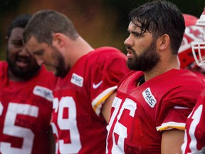 Med student Laurent Duvernay-Tardif, right, said learning to rebound and move on from tough cases in the emergency room has also helped him move on from loses on the field, such as the Kansas City Chiefs' heart-breaking 18-16 AFC divisional playoff defeat last year.