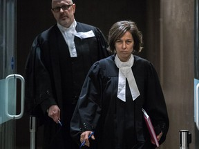 """Crown prosecutors Marlene Archer and Pascal Lescarbeau leave the courtroom at the Palais de Justice in Montreal Feb. 3, 2017, after Archer revealed she had """"involuntarily mislead"""" the court in disclosure of wiretaps."""