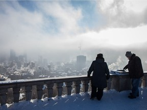 The Montreal city skyline from the Mount-Royal summit on a cold and smoggy winter day in 2015.