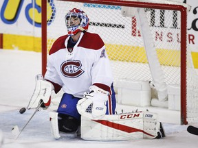 Montreal Canadiens goalie Al Montoya reacts to letting in a goal during second-period NHL hockey action against the Calgary Flames in Calgary, Thursday, March 9, 2017.