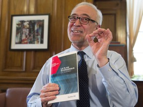 Quebec Finance Minister Carlos Leitão displays his budget speech on the eve of a provincial budget on Monday, March 27, 2017 in Quebec City.