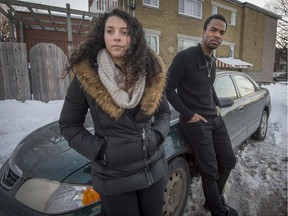 Helena Backa, left, and Andrew Denis-Lynch by their car in Montreal, on Saturday, March 18, 2017. Denis-Lynch is an acting student who says he was a victim of racial profiling by police and his girlfriend stepped in to help defuse the situation.