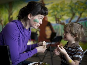 Kate Horgop and her three-year-old son Philip Peters enjoy a lunch together as they attend the Milton Earth Day Gathering across the street from Parc Leo-Pariseau in Montreal on Saturday, April 22, 2017.